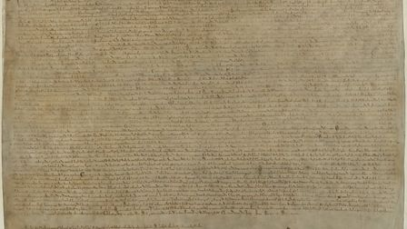 A 1215 copy of the Magna Carta, held by the British Library. PHOTO: British Library