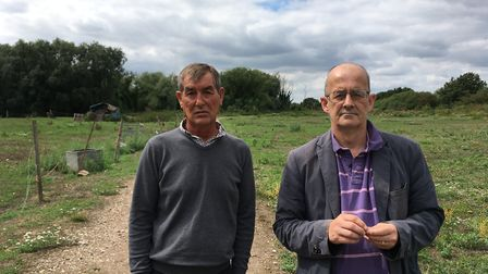 William Brazil (l) and Stuart Carruthers (r) on the land being disputed off Swanton Lane. Photo: Arc