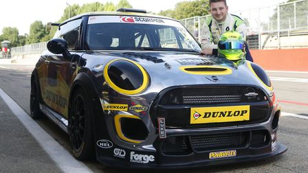 Dereham''s Dan Zelos posing with the Dunlop-supported 265bhp Mini Challenge car he will race in this