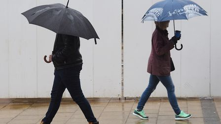 Chance of rain this August bank holiday weekend. File photo of umbrellas up in the rain and wind in