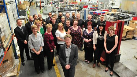 Managing director Esther Evans (centre) and the team at STM Packaging in Norwich in 2013. The compa