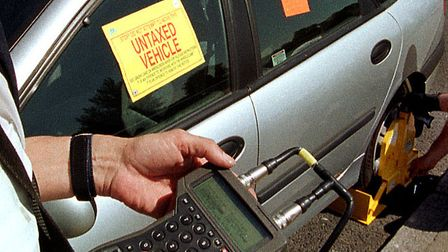 Stock photo of a car being clamped. .Photo: NICK STRUGNELL