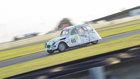 The Greg Page-led Watton-based Team Iceni car negotiating the Esses Complex as the light fades on Sa