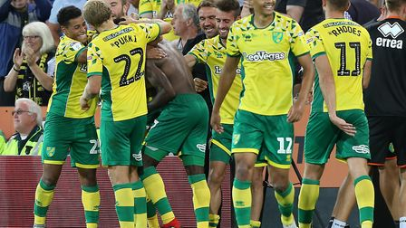The Canaries players congratulate Alex Tettey after his thumping strike sealed a 2-0 win over Presto
