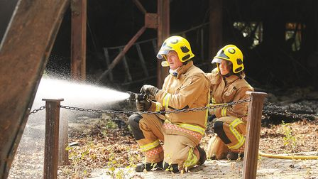 North Lynn retained firefighters Becky Hornigold and Mel Tibbs at a fire in west Norfolk in July. Pi