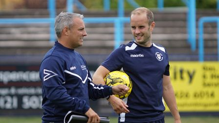 Lowestoft Town boss Jamie Godbold talking with the injured Andrew Fisk before the match. Picture: Sh
