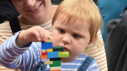 Mabel Marczewski, three, concentrates on constructing her Lego tower at the Forum. Picture: DENISE B