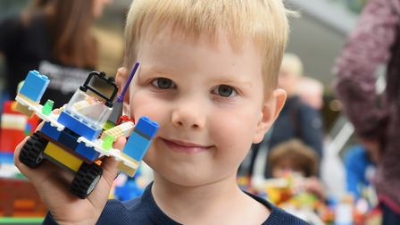 Marcus Joubert, four, with his Lego model at the Forum. Picture: DENISE BRADLEY