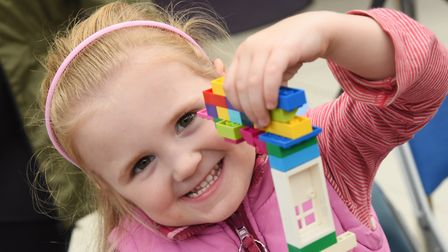 Sophie Barnes, four, with her Lego model for a futuristic Norwich, at the Forum. Picture: DENISE BRA