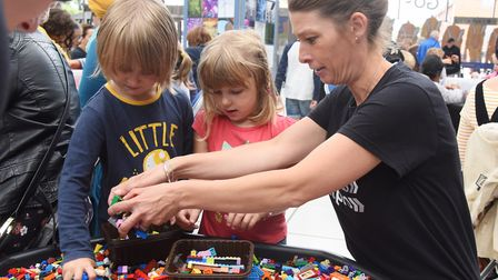 Children collect Lego to construct models for a futuristic Norwich, at the Forum. Picture: DENISE BR