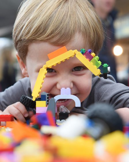 Seth Bennell, two, with hus Lego model crane at the Forum. Picture: DENISE BRADLEY