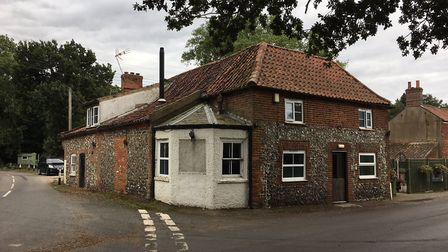 A North Norfolk landlord says his village pub is not going to close despite signage being taken down