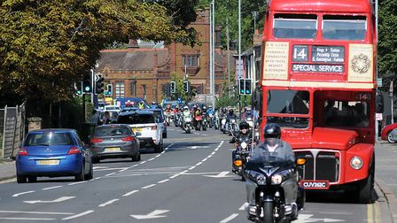 A red double decker bus led the procession, carrying mourners to Jac Coffey's funeral Picture: Chri