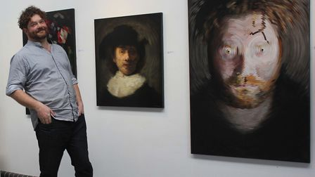Will Teather with his radial paintings. Picture. Dot Howard