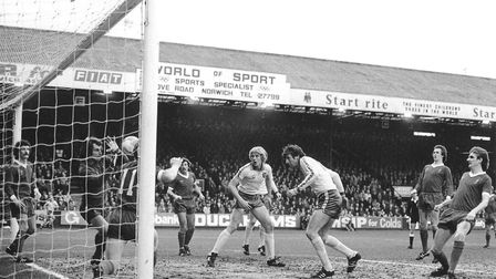 Martin Peters heads for goal during Norwich City's 5-3 defeat to Liverpool at Carrow Road. He would
