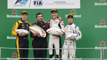 Norfolk''s George Russell, second right, celebrates his fifth FIA Formula Two victory at Monza Pictu