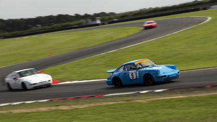 Robert Hollyman (Porsche 9 ) on his way to victory in the Intermarque race at Snetterton Picture: El