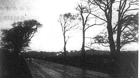 Weird Norfolk: The old man of Hopton. Pictured: Night closes in on the A12 where a Lowestoft police
