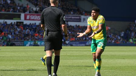 Onel Hernandez pleads with the referee for a decision to go his way
