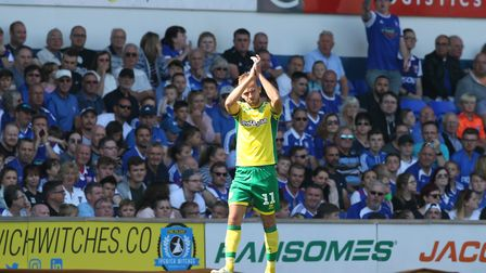 Former Town striker Jordan Rhodes applauds the travelling Canaries supporters as he makes way for De