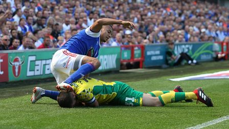 City skipper Grant Hanley holds his face after clashing with Ipswich's Kayden Jackson
