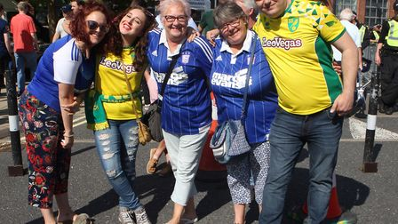 Ipswich Town and Norwich City fans mix before their Championship clash