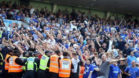 Ipswich supporters celebrate seeing their side go in front
