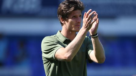 Timm Klose of Norwich applauds the traveling support at the end of the Sky Bet Championship match at