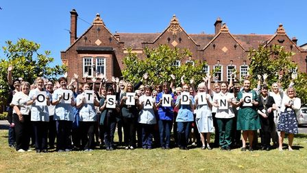 Norfolk Community Health and Care NHS Trust staff celebrate their outstanding rating. Pic: NCH&C NH