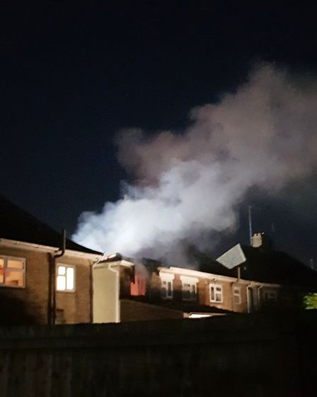 Smoke billowing from the house at the height of the blaze Picture: Submitted