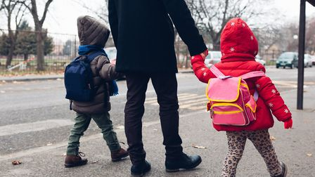 Off to school with daddy. Getty Images/iStockphoto