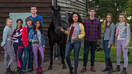 The cast of the second series of Free Rein, including Jaylen Barron (who plays Zoe) with the horse t