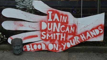 A sign painted by Vince Laws and used in the production. Photo: Ann Nicholls