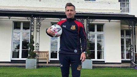 Former Norwich player Darren Eadie dressed for his role as head of football at St Joseph's College i