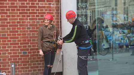 Nearly 100 people of all ages have abseiled 50ft down a famous Norfolk building for charity. PHOTO: