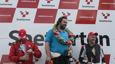 Robert Hollyman, on the top step of the podium, celebrating victory in last year''s Aston Martin Int