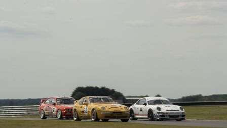Action from last year's Aston Martin Owners Club meeting at Snetterton with the 44 Porsche GT3 of Pe