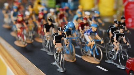 The model Tour de France cyclists in Peter Martin's collection spanning over 20 years of visits to t