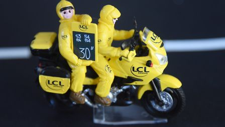 A model Tour de France race officials on motorbike in Peter Martin's collection. Picture: DENISE BRA