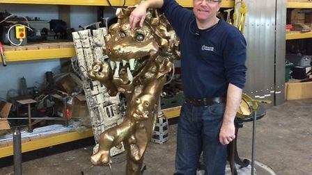 Simon Michlmayr with the lion from the Gurney Clock when it was put into storage in 2015. Pic: Submi