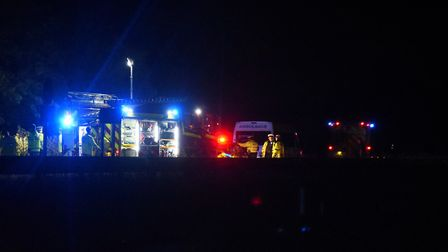 Police, fire, and ambulances at the scene of an accident at the Ketteringham junction Norwich bound