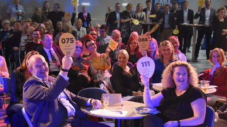 Bidders raise their paddles at the start of the Break charity's GoGoHares auction. Picture: DENISE B
