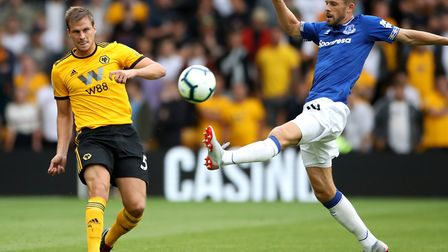 Ryan Bennett is closed down by Everton's Gylfi Sigurdsson during Premier League action for Wolves Pi