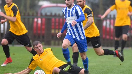 Wroxham (stripes) beat Fakenham 2-0 at Trafford Park in the second round of the Norfolk Senior Cup e