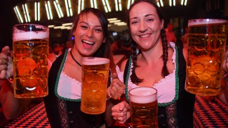 Bavarian waitresses Kaley Mais, left, and Kate Bloomfield at the Norwich Oktoberfest at the Open. Pi