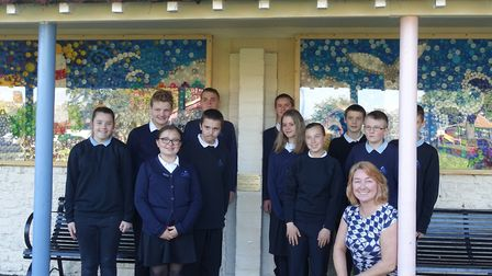 The pupils and their teacher, Harriet Chambers, with the murals on display. Pictures: FONEP