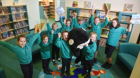 Dussindale Primary School library. Some of the pupils holding Dudley, the librarian. Picture: ANTONY