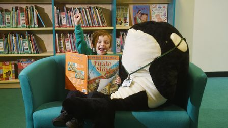 Dussindale Primary School library. A pupil with Dudley, the librarian.Picture: ANTONY KELLY