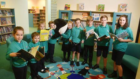 Dussindale Primary School library. Some of the pupils holding Dudley, the librarian.Picture: ANTONY