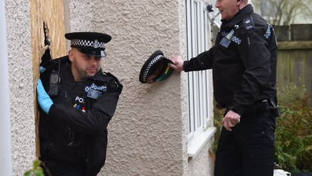 Police during a drugs raid in Norwich. Photo: Denise Bradley